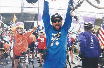 Crossing the finish line of the California AIDS Ride, 1996 (radio gear strapped to my chest the whole way!)