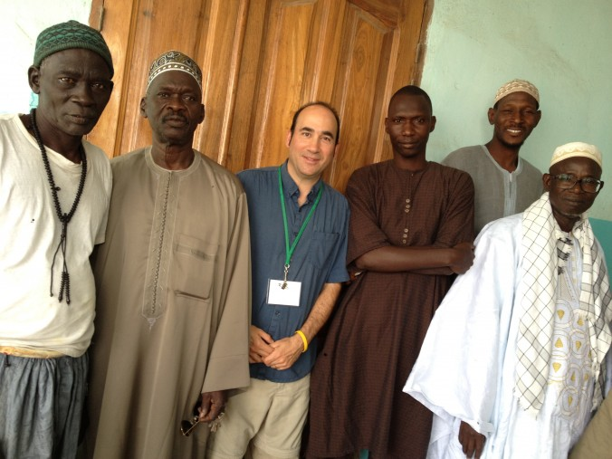 """With imams in Dakar, Senegal mosque, while doing """"Sahara Ceiling"""" special on status of women"""